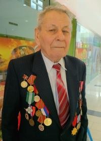 pán Chudík s medailami