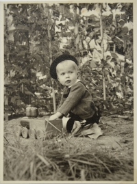 Augustin in September 1940 - playing with a train in the garden