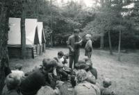 Jiří Zajíc (standing with a book) camping in Holostřevy; ca. 1985