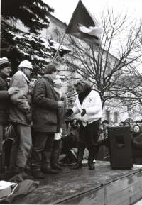 Monika Brázdová, second from right, on the stage with other students during the demonstration at Horní náměstí in the town of Humpolec on the day of the general strike November 27, 1989