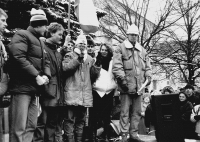 Monika Brázdová speaks into a mic at a demonstration at Horní náměstí (a square) in the town of Humpolec on the day of the general strike November 27, 1989