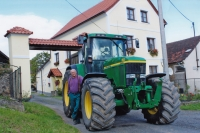 Jan Kreysa with a tractor in front of the family farm