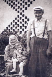 Grandfather with grandmother holding his sister