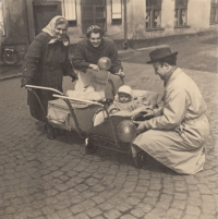 Stanislav duchek in a baby stroller; in a pram next to him is his sister; from left: his grandmother, mother and father