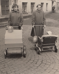 Stanislav Duchek in a baby stroller with his mother. In the pram on the left is his sister accompanied by his mother's friend Marcela Kuncová