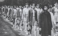 Magda (5. řada vlevo na kraji) cvičí na spartakiádě v Prešově, 1960