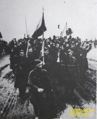 Crossing the border at Dukla - in the foreground a flag bearer Vladimír Kunášek / Source: archive of Václav Širc