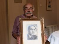 Josef Kleim with portrait of his father Emil Klem