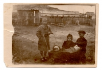 Lavrentiya Talanchuk (far left) takes care of the neighbors' children at the special settlement, 1950s