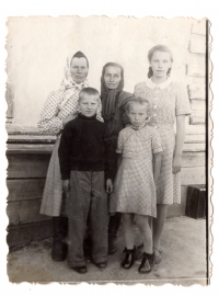 Sofia, Bohdana and Lavrentiya Talanchuk with neighbors at the special settlement, 1953