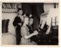 "Artemiy's children - Andriy, Lesya, Bohdana. Tomsk, Vokzalnaya Street. 1955. Piano ""Belarus"", bought in Tomsk, brought to Ukraine."