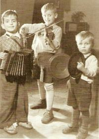 S. Karásek as a boy, playing with his brothers