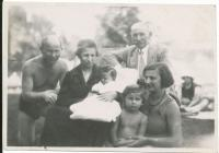 With her parents, grandparents and sister