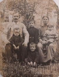 Parents and siblings of husband Dmitrij (center)
