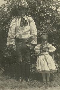 Father Josef Šalamun with Emilia dressed in Croatian folk costume