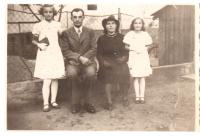 Family Šalamun in front of their house in Frélichov