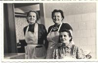 With her sister Lida and their mother in a kitchen