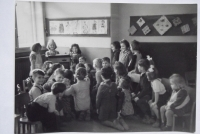 With children in kindergarten (at the back, looking into the camera)