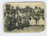 Zamochok village. Nadiya-Anastasiya Gryshchak (forth one in second raw from left to right side) together with classmates in forth-fifth grade of primary school (approximately 1934-1935). Teacher – Yelyzaveta Zaklika, Pole