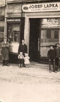 Father J. Footpad with Matilda and Jaroslav family business before the Komensky Square