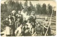 On the floating. Krasnoyarsk region, river Tuhach, Maryan-Klyn, 1948. Teklya Tykhan with a stick in hands
