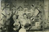 Mykytka's Family with their five children. Stand: Dauchters Lyubomira and Aniziya. Sit: son Orest, Fr. Markiyan with youngest son Bogdan and Mrs. Maria with son Yuriy. Special settlement Dzhonka, Khabarovsk krai in the Far East of the USSR, 1956.