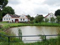 Houses no. 12 and 13  by the village pond in Vřesce