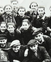 Alžbeta among classmates (in the middle)