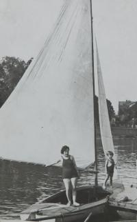 Milan Vlcek with her mother in a rental boat in Prerov, owned by father