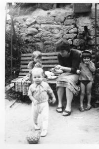 Wife Michaela with children in front of the house in Marxova street in Mladá Boleslav, where in this time the Jirounek s family lived.