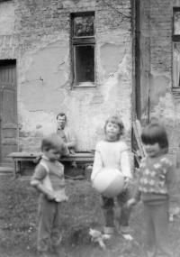 Mirek Jirounek with children in the yard of church of Moravian Brethern in S.K. Neumann street  in Mladá Boleslav - 1985