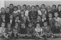 1st grade in 1944, third from left in the front row
