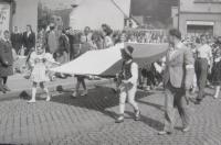 The parade in basketball in 1948. Blanka Andělová carries Slovácké costume Czechoslovak flag