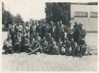 Stanislav Husa – group of barricade-builders at Žižkov cargo train station (second in the first row, sitting), historical photograph, May 9, 1945