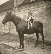 Prokop Šmirous (with blonde hair) on his native farm in Leština u Světlé