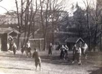 A group of Petr's friends playing dodgeball in the yard of Jewish school in Frýdek
