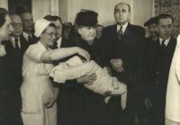 1946 - the christening of Jan Kucera, in arms of Hana Benesova, mother (left), father (right)