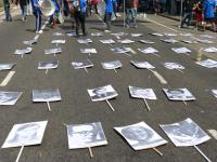 Photos of disappeared persons laid on the street on the occasion of the military putsch anniversary (24/03/2016, Buenos Aires)