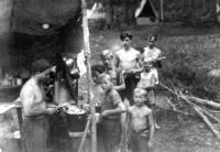 Lunch in the first post-war scout camp on the Jihlávce river / Josef Svoboda as the highest in a cue/ 1946