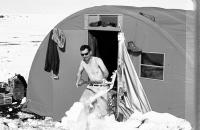 Josef Svoboda cleans snow away in front of a field research dormitory / Canada / 1970
