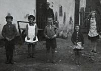 Irena Ondruchová in a white apron at the couryard of the house in Výškovice in 1936
