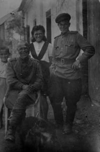 Irena Ondruchová, cousin Luboš Adámek and her dog Alík with Russian soldiers in Výškovice in May, 1945
