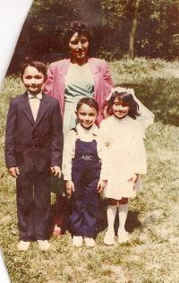 First Communion. Mária with her mother and brothers in 1988