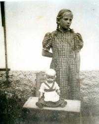 Maria with her dolly, which she took to Germany