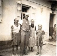 Family Pache in front of their house