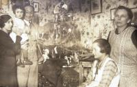Mum Irena, Hana, father Arnold, an unknown person sitting, cook Karla. Christmas 1932