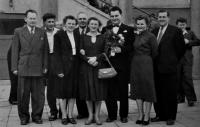 Leo Ulmann with flowers in the middle / Květoslava's birth brother / graduation from the faculty of veterinary medicine in Brno / 1950s / Květoslava on his right