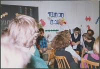 Mikuláš in the white kipa celebrating Chanuka at the Lauder Schools, Prague about 1998