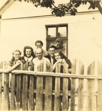 Emilie (on the right) with her family