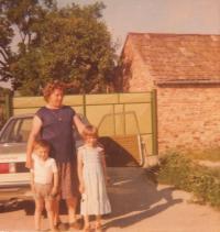 Franjica Poznik with grandson Nikola and granddaughter Andrijana, in front of family home, 1981, village of Beska, Vojvodina, Serbia